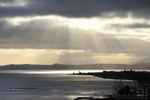 Sun Rays Over CToward Lighthouse